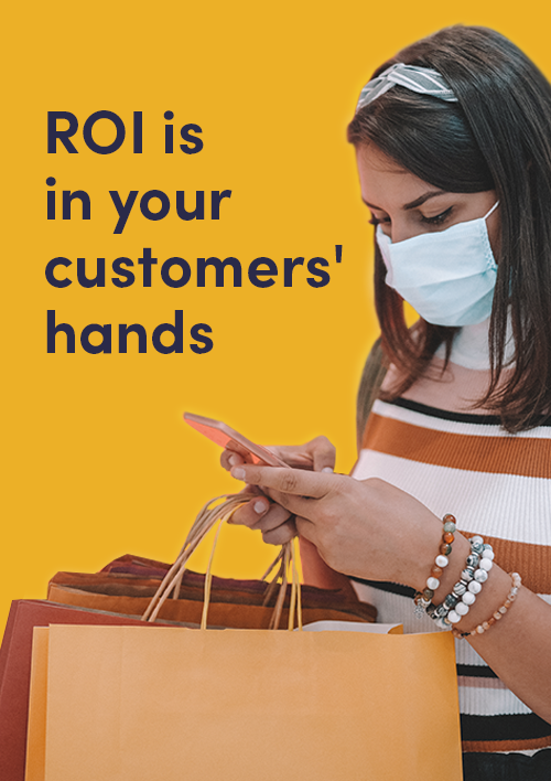 mage of a woman in a store looking at her phone with the title saying ROI in your customer hands